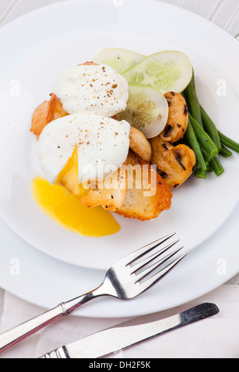 poached egg with salad, mushroom and bread - Stock Image