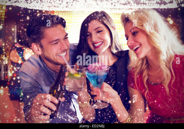 Composite image of friends with drinks - Stock Image