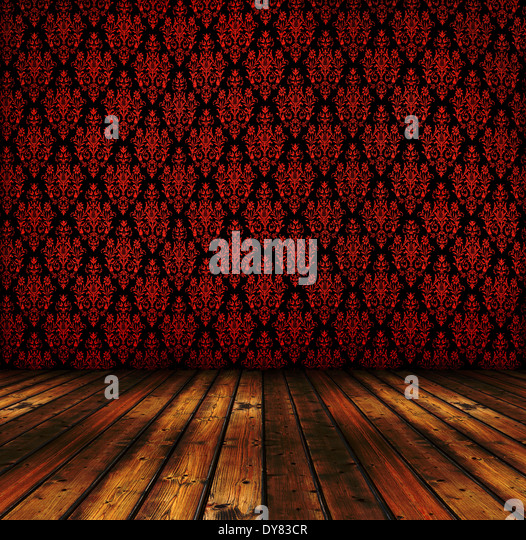 grunge room interior with vintage red wallpapers and wooden floor - Stock Image