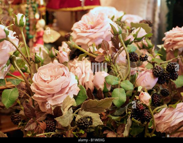 plastic roses with blackberries - Stock Image