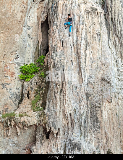 Young female rock climber, concept for overcoming obstacles. - Stock Image