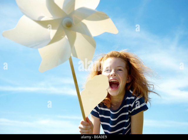 Young girl laughing with windmill - Stock Image