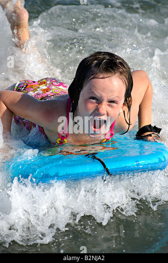 Girl on a wave board enjoying the ride Ocean City New Jersey USA - Stock-Bilder