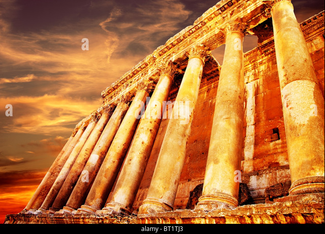 Jupiter's temple ancient Roman columns over sunset, Baalbek, Lebanon - Stock Image