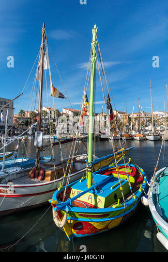 Mediterranean Fishing boats at Sanary-Sur-Mer , Promenade, Mistral Clouds, Cote d Azur, France - Stock Image