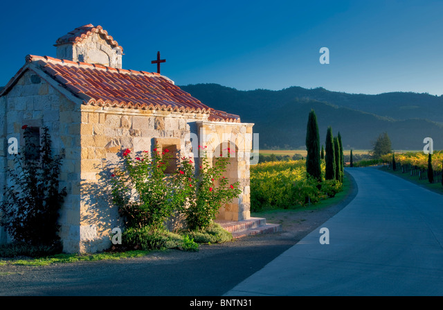 Small chapel with roses at entry of Castello di Amorosa. Napa Valley, California. Property released - Stock Image