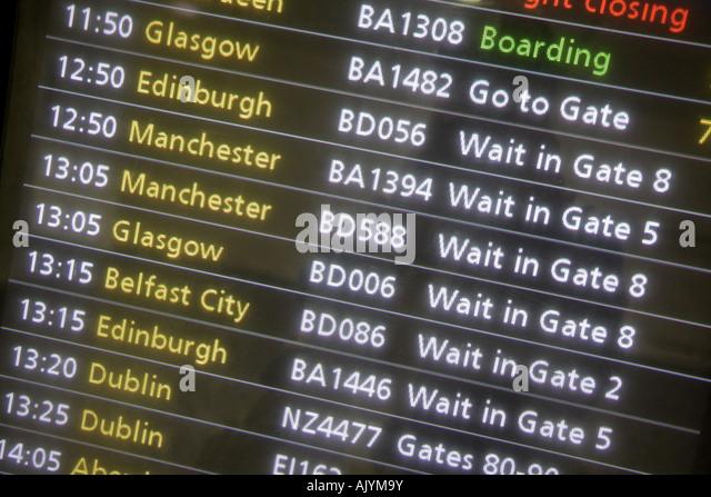 England UK London Heathrow Airport departure schedule monitor screen - Stock Image