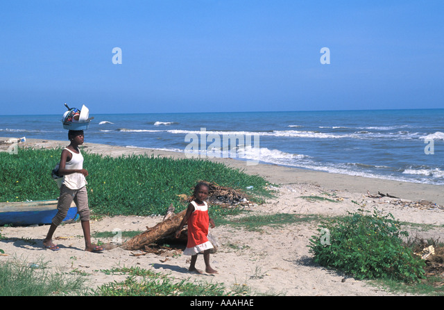 Honduras Garifuna mother and daughter walking on beach Sambo Creek Village Caribbean coast Central America - Stock Image