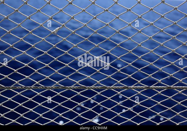 Net with deep blue sea on a background. - Stock-Bilder