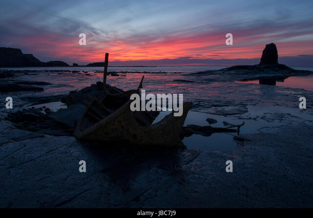 A beautiful sunset over the wreck of the Admiral Von Tromp at Saltwick Bay, Whitby on the North Yorkshire Coast - Stock Image