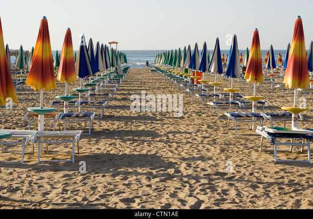 rows of colorful beach umbrellas - Stock Image