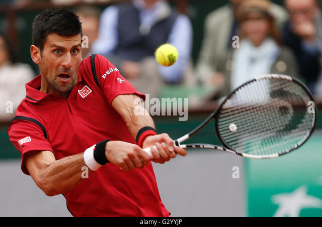 Paris, France. 5th June, 2016. Novak Djokovic of Serbia hits a return to Andy Murray of Britain during the men's - Stock-Bilder