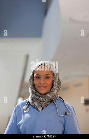 Portrait of a female nurse smiling - Stock Image