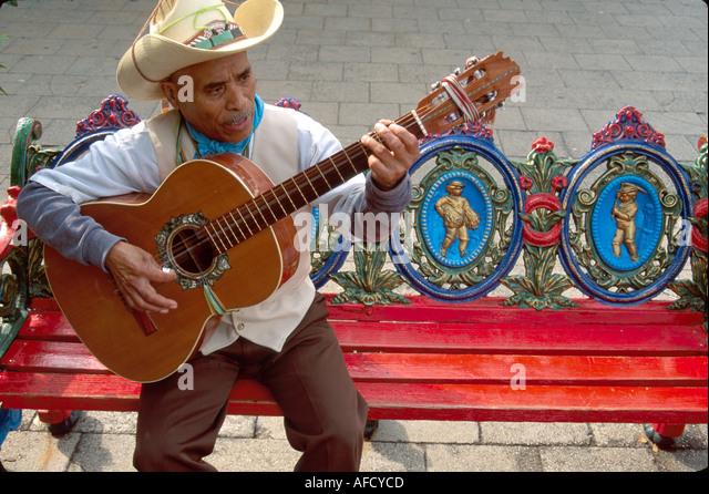 Texas The Southwest San Antonio Market Square El Mercado troubadour ornate bench by La Margarita Restaurant TX004 - Stock Image