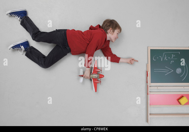 Boy learning speed of sound - Stock Image