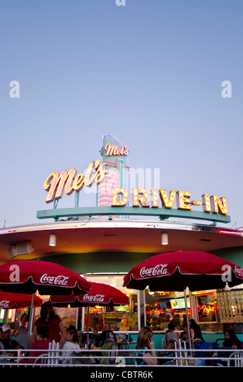 Mel's Drive-In restaurant with diners outdoors at twilight Universal Studios Orlando, Florida. - Stock Image
