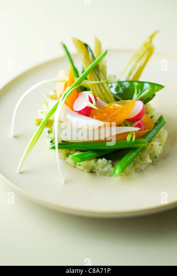 Mashed potatoes with steam-cooked vegetables - Stock Image