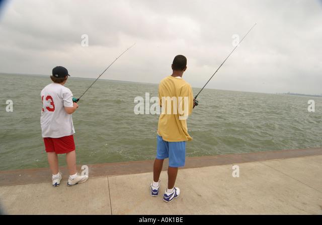 Ohio Sandusky Lake Erie Jackson Street Pier fishing teens Black African American - Stock Image