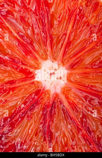 Extreme close-up of a blood orange. - Stock Image