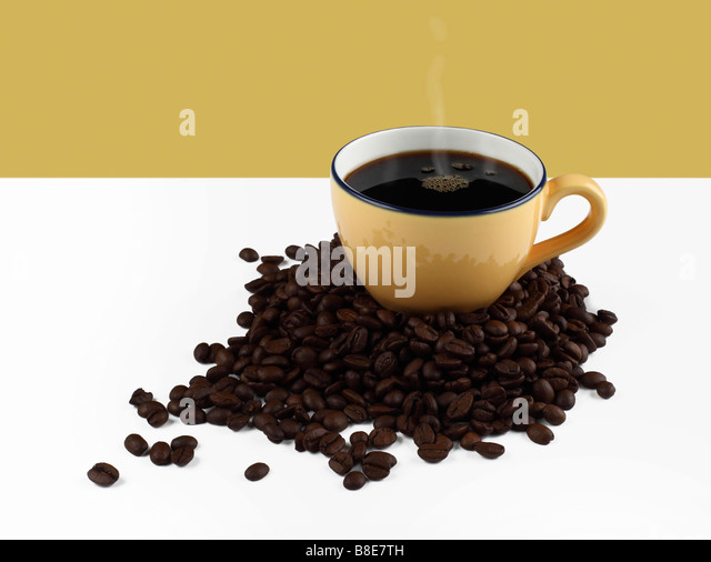 Cup of hot organic coffee on Coffee beans - Stock Image