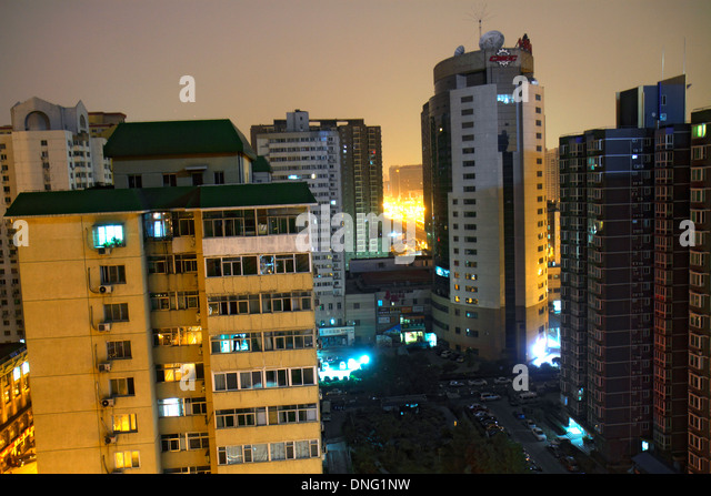 China Beijing Xicheng District apartment buildings city skyline aerial high rise night aerial - Stock Image