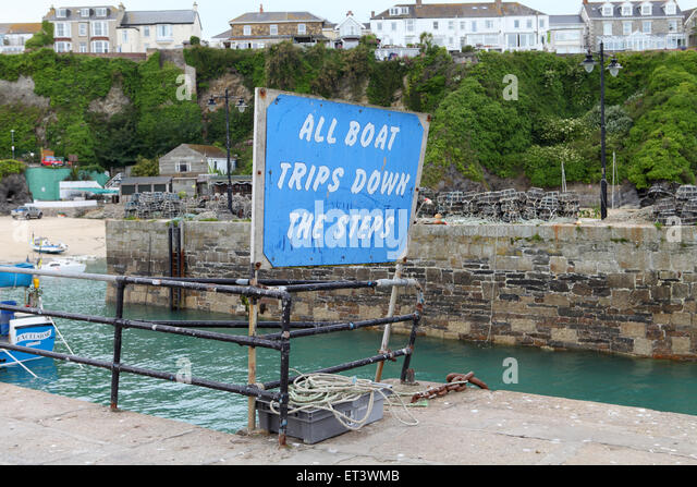 Sign for tourist boat trips at Newquay Harbour in Cornwall - Stock Image