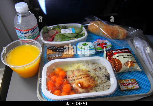 Paris France Europe French CDG Charles de Gaulle Airport American Airlines Miami flight economy seat in-flight meal - Stock Image