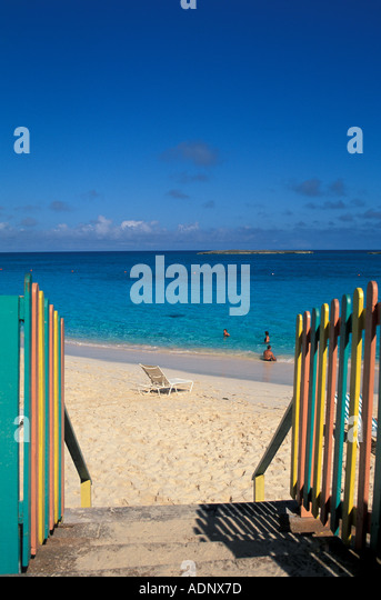 Bahamas Pardise Island Beach people in water colorful fenceline - Stock Image