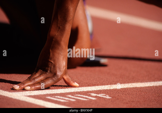 Detail of sprinter hand at the starting line. - Stock Image