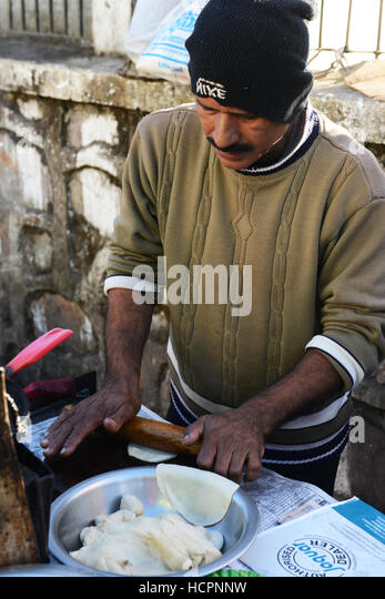 Puri ( fried dough bread ) is a popular breakfast in northern India. - Stock Image