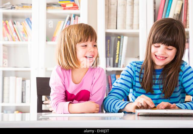 Two girls having fun - Stock Image