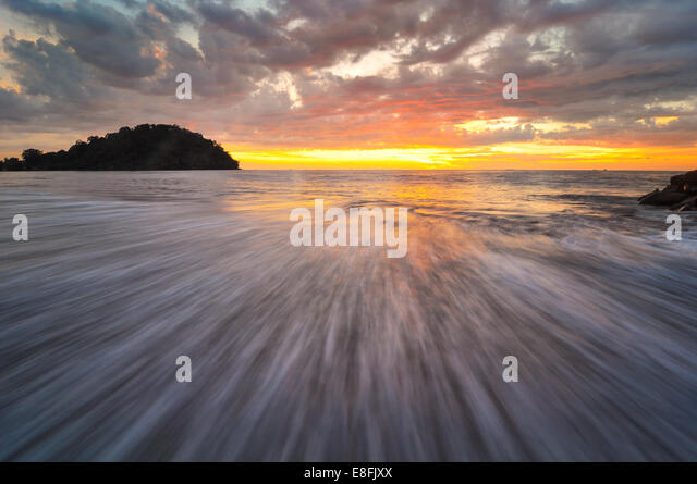 Indonesia, Padang, Taplau Beach, Wave and sunset - Stock-Bilder