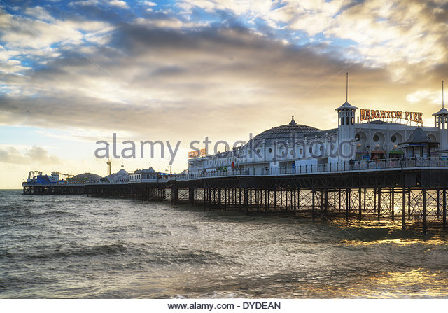 Winter sunset over Brighton Pier on the south coast. - Stock Image