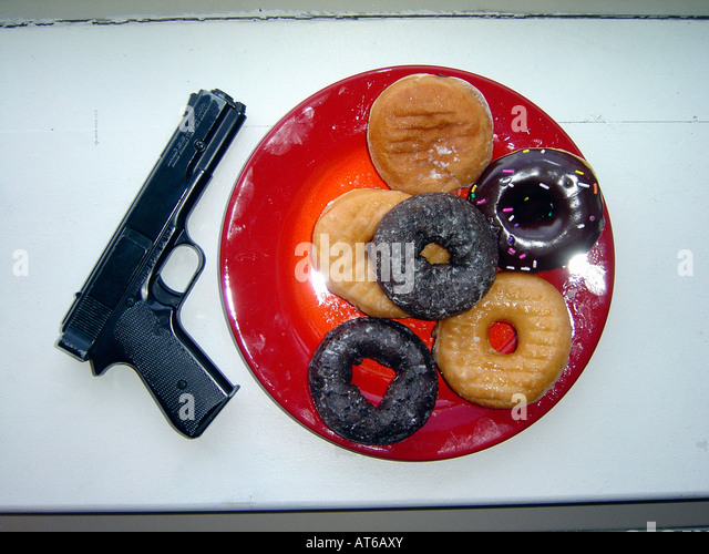 Still Life of a Red Plate With Six Donuts Near a Police Pistol - Stock Image