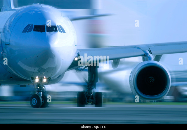 Close up of commercial aeroplane taxiing - Stock Image