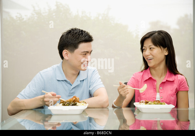 Two office workers having lunch and smiling - Stock-Bilder