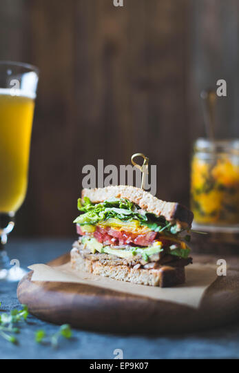 Tempah bacon, lettuce, tomato sandwich with kimchi, Avocado and Chipotle Mayonnaise - Stock Image