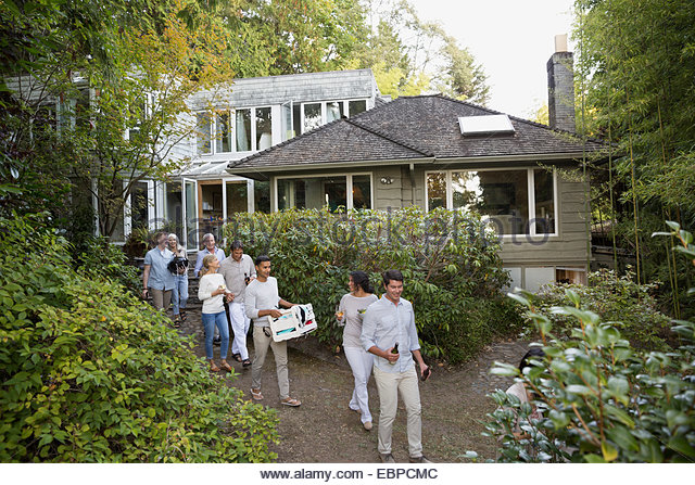 Friends carrying food and drink on path - Stock Image
