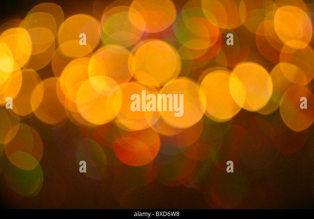 Abstract pattern of coloured lights blurred and out of focus - Stock Image