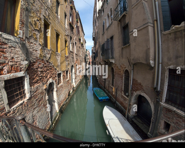 Showing her age: a side canal, Venice, Italy - Stock Image