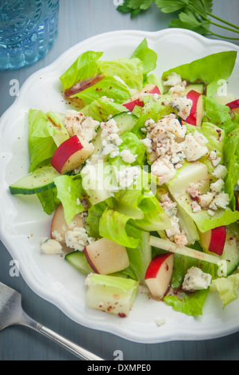 A Salad of Greens, Blue Cheese, Red Pears, Cucumber and Cranberry Vinaigrette - Stock Image