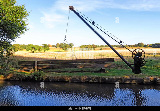 Bridgewater Canal lifting machine crane, Moore, Warrington, Cheshire, England, UK - Stock Image