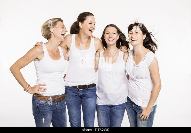 Studio portrait of four happy mid adult women - Stock Image