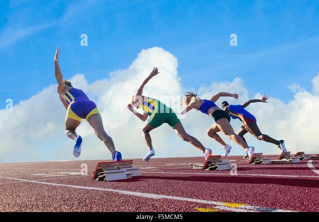 Four female athletes on athletics track, leaving starting blocks, rear view - Stock-Bilder
