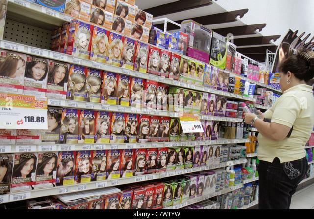 Nicaragua Managua Plaza Espana La Colonia Supermarket grocery store shopping shelves shelf competing products for - Stock Image