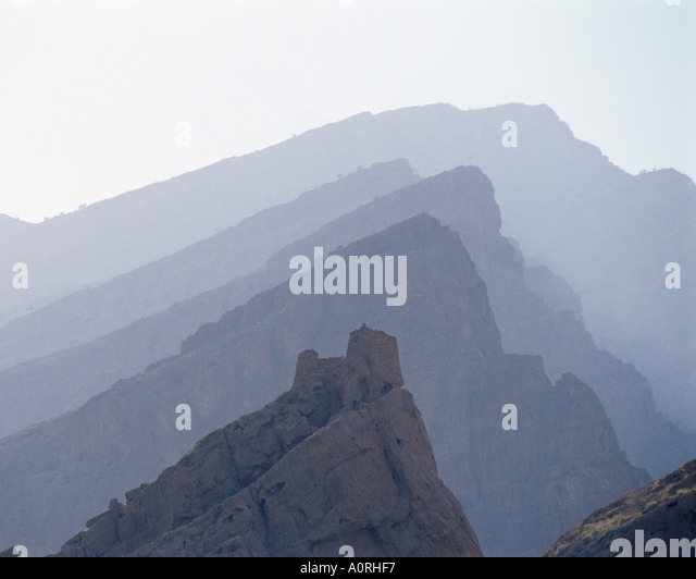 Mountain Ridges Persian Ruin Sultanate of Oman - Stock Image