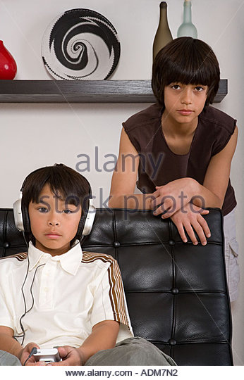 Two moody boys - Stock Image