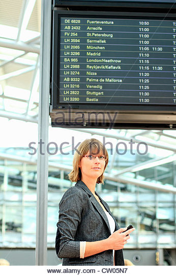 Businesswoman walking in airport - Stock Image