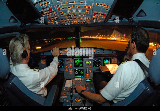 Pilots in the cockpit of an Airbus 321 after landing, taxiing to gate - Stock Image