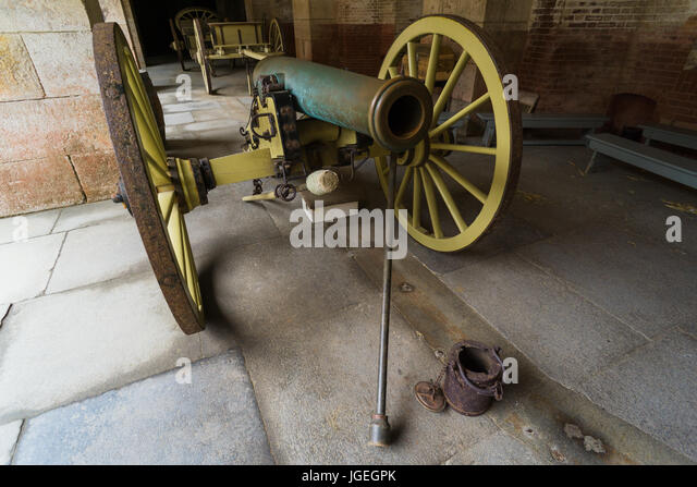 Bronze cannon in a military fort, oxidized by the ocean - Stock Image